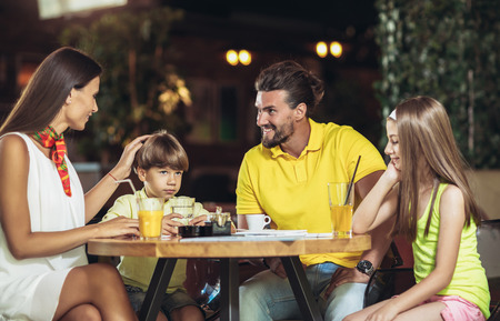 Four-member family having great time in a restaurant