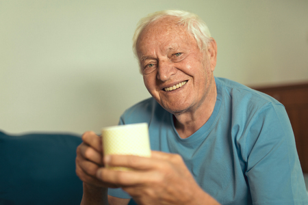 Portrait of senior man  at home Stock Photo