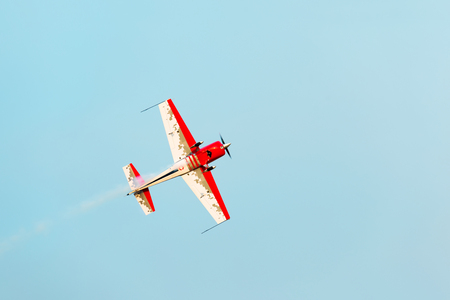 Flying the plane performs aerobatics in the sky Stock Photo