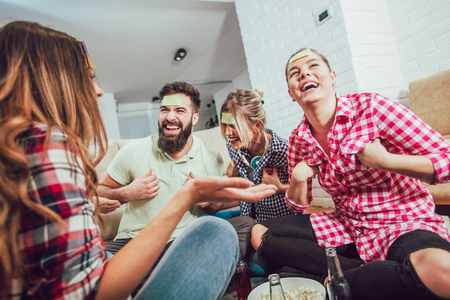Diverse people playing game guess who and having fun at home Stock Photo