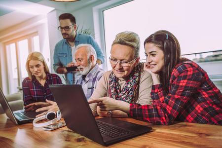 Young volunteers help senior people on the computer Stock fotó