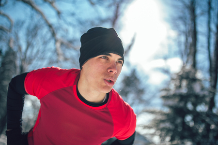 Man Sportsman Taking Break From Running in Extreme Snow Conditions Stock Photo