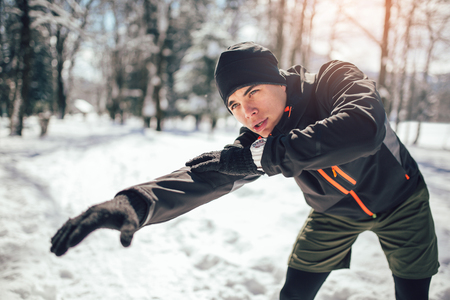 Man Sportsman Taking Break From Running in Extreme Snow Conditions 写真素材