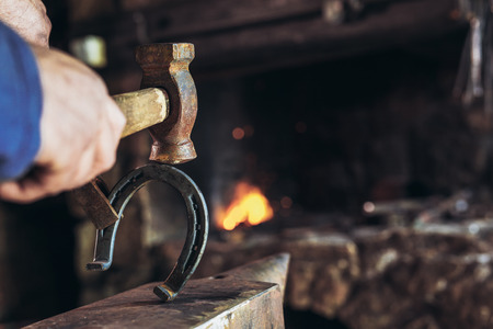 Blacksmith forging a horseshoe