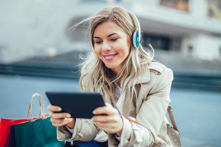 Happy woman watching media content in a digital tablet Stock Photo - 98318128