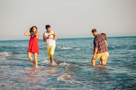 Group of friends together on the beach having fun.