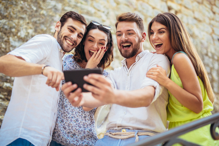 Group of young tourist friends with digital tablet having fun Stock Photo