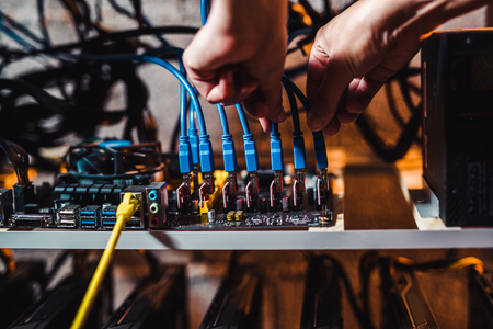 Programmer configures hardware for bitcoin mining