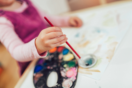 Girl, preschooler, painting with water color, close up. Stockfoto