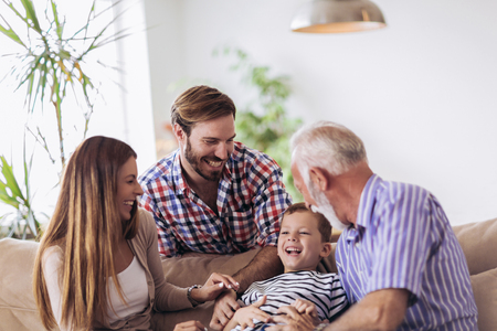 Portrait of a three generation family spending time together at home Stock Photo
