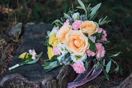 Beautiful wedding bouquet lying on wooden boards