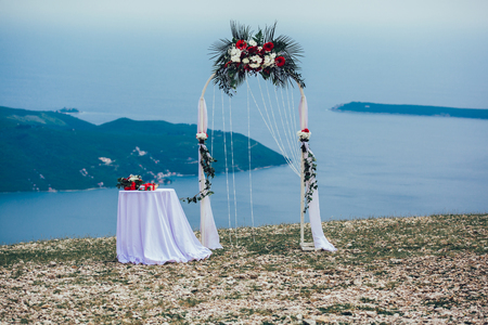 Forged wedding arch. Wedding on the sea Stock Photo
