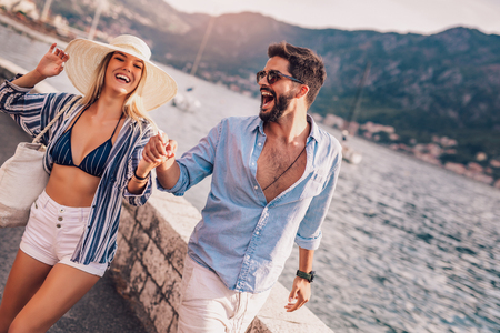Couple in love, enjoying the summer time by the sea. Stock Photo - 115229992