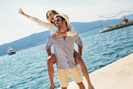 Couple in love, enjoying the summer time by the sea. Stock Photo