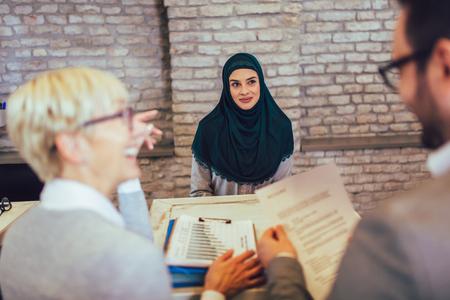 Muslim woman, job applicant having interview Stock Photo