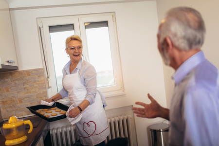 Senior woman with fresh baked cookies Stock Photo