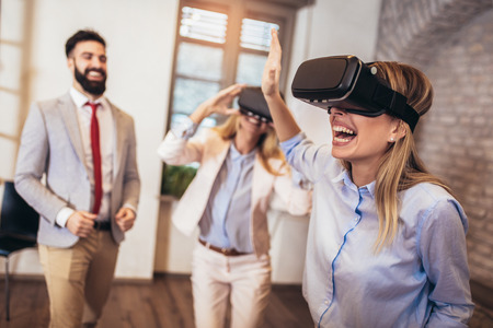 Business people making team training exercise during team building seminar using VR glasses