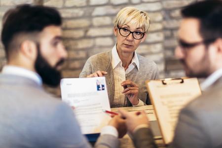 Senior woman,  job applicants having interview Stock Photo