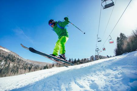 Skiing. Jumping skier. Extreme winter sports. Zdjęcie Seryjne