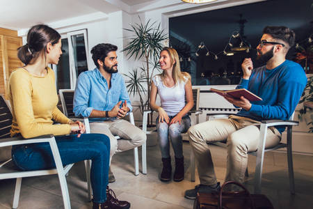 Support group meeting for people struggling with addiction Stock Photo
