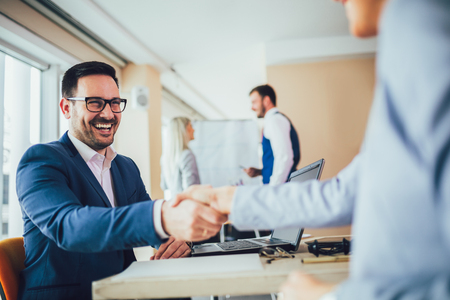 Close-up of business people handshaking Stock Photo