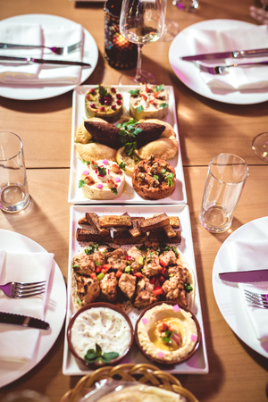 Table with various arabic food served in restaurant