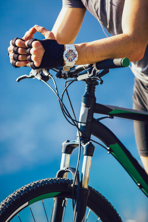 Close-up of a riders hand on a mountain bike handlebars Stock Photo