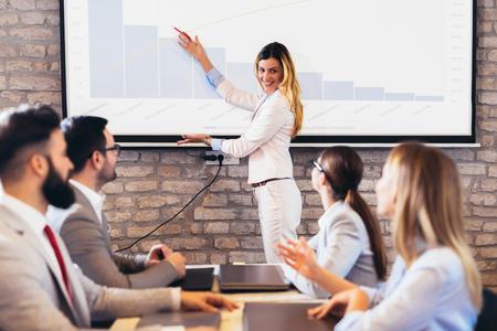 Confident speaker giving public presentation using projector in conference room Standard-Bild - 122887268