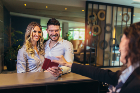 Young couple at the hotel reception
