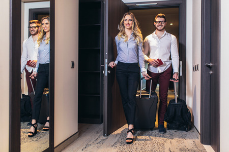 Vacation for couple. Young couple entering the hotel room together Banco de Imagens - 124766415