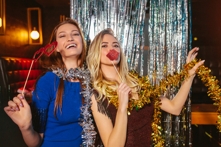 Girls celebrating new years eve at the nightclub. Group of female friends partying in pub Stock Photo
