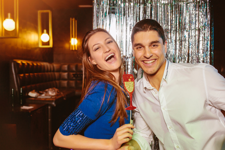 Romantic young couple having fun in the night club. Man and woman in the pub.