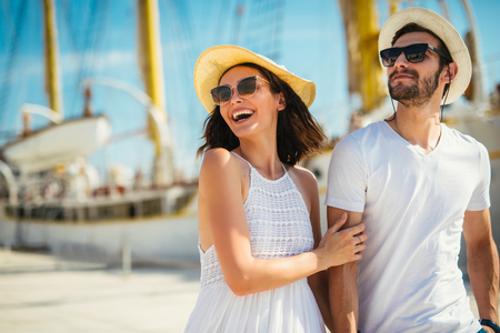 Young beautiful tourist couple enjoying summer holiday on the seaside Stock Photo