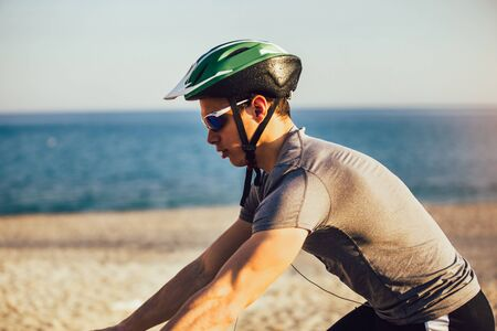 Man ride mountain bike on the beach. Sport and active life concept.