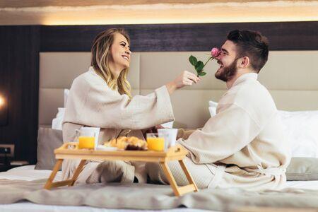 Young happy couple having breakfast in luxury hotel room. Stok Fotoğraf - 124872429