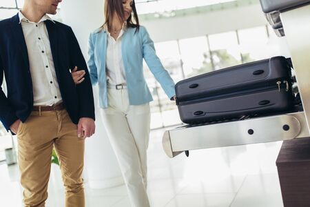 Business travelers put baggage on X-ray machine try to detection metal prevention at the airport before take off