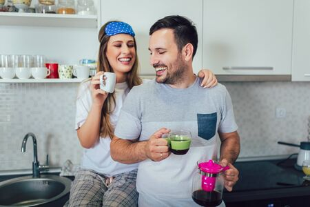 Young couple enjoying a morning coffee at home. Reklamní fotografie