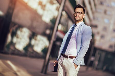 Portrait of a young happy businessman outside the office building Stock fotó