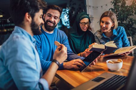 Group of students of diverse ethnic learning at home. Learning and preparing for university exam, selective focus. Banco de Imagens - 129739622