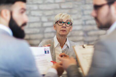Senior job applicant having interview in modern office Stock Photo