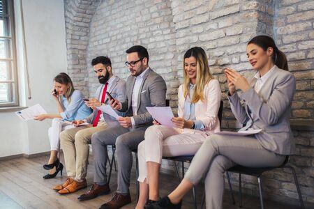 Job applicants having interview in modern office
