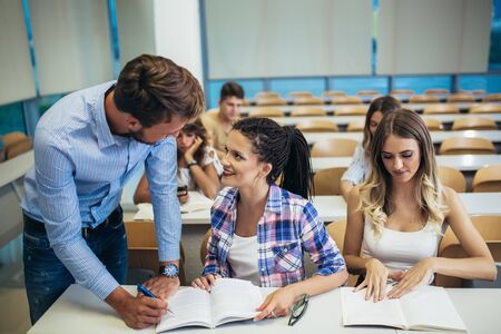 Young students listening to professor in the classroom on college Stock Photo