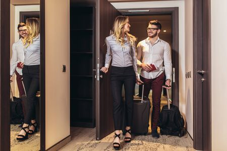 Vacation for couple. Young couple entering the hotel room together