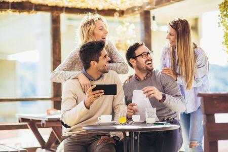 Group of friends in cafe, using digital devices Reklamní fotografie
