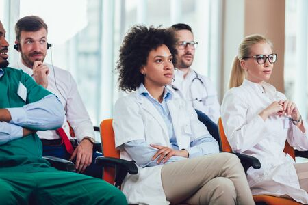 Group of doctors on seminar in lecture hall at hospital. Hospital, profession, people and medicine concept Stock Photo