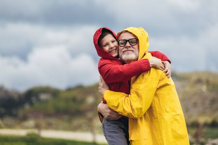 Father and son in the countryside on a rainy day
