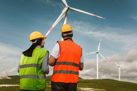 Windmill engineers inspection and progress check wind turbine
