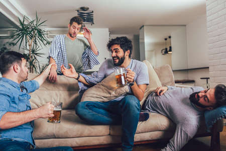 It was great party! Drunk guys are sleeping after night events on the floor and sofa in different pose in living room. Stockfoto