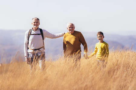 Three generations of family hiking together in the autumn. Stock fotó