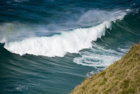Waves about to crush on the Cliffs photo